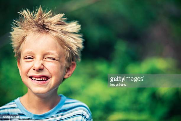 funny little boy winking - bad hair stock pictures, royalty-free photos & images