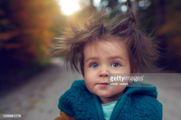 funny little girl with dizzy hair - frizzy stock pictures, royalty-free photos & images