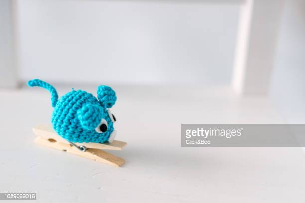 A funny little mouse glued to a clothespin on a white chair (handmade)