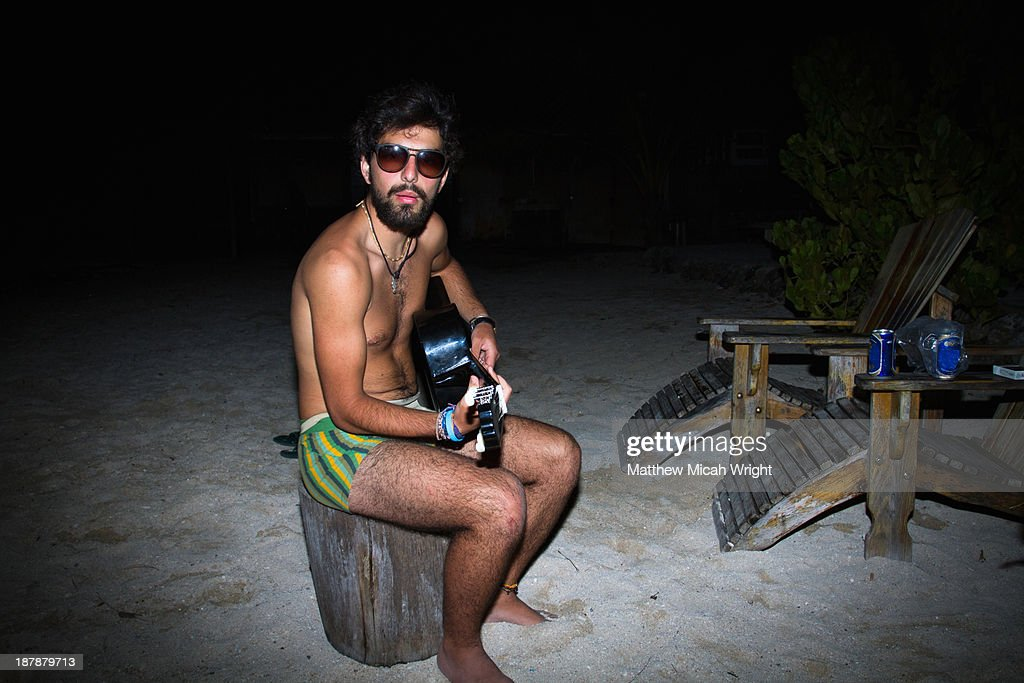A funny man playing music in underwear : Stock Photo