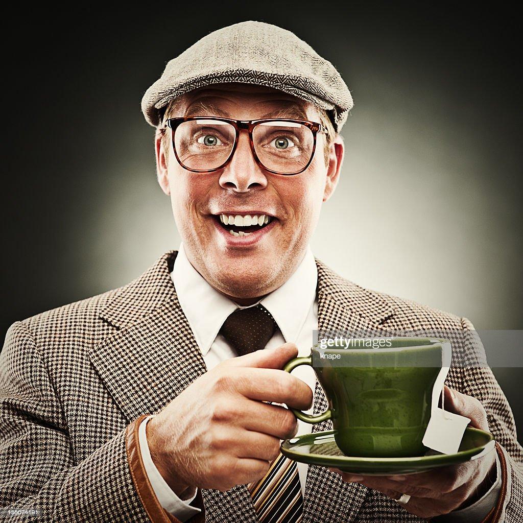 Funny man smiling with tea wearing porkpie hat : Stock Photo