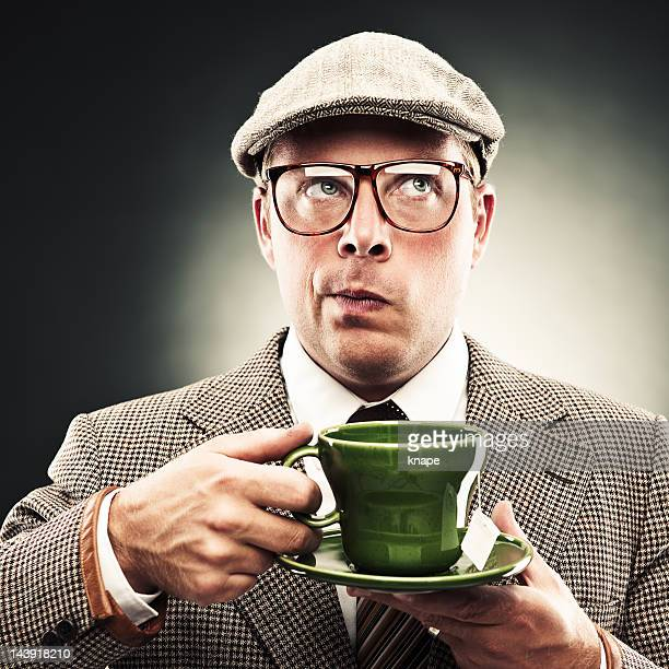 funny man with tea - british culture stock pictures, royalty-free photos & images