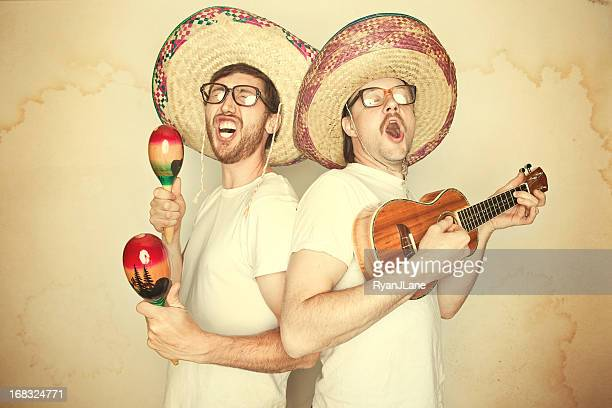 funny mariachi band with sombreros - acoustic guitar stock pictures, royalty-free photos & images