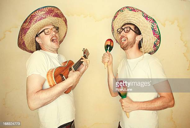 funny mariachi band with sombreros - maraca stock photos and pictures