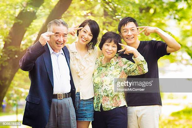Funny mature Japanese family portrait in park