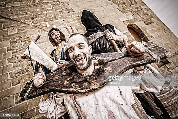 funny medieval public beheading - guillotine stock photos and pictures