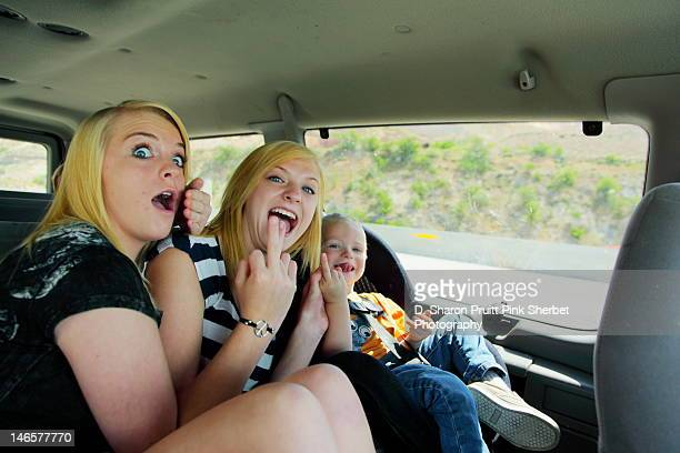 funny naughty car passengers - kid middle finger stock pictures, royalty-free photos & images
