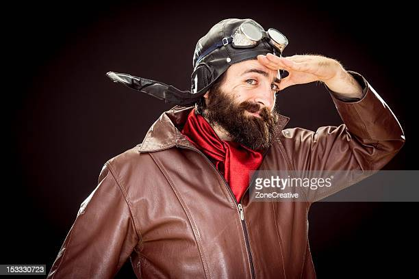 Funny old style pilot in 'as commanded' pose