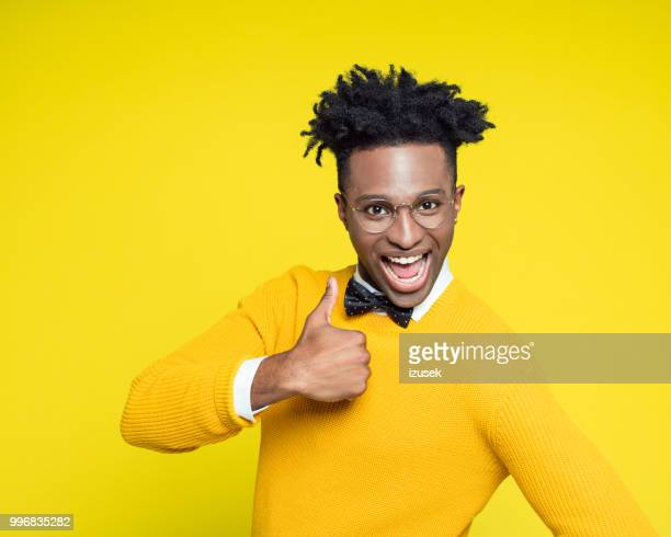 Funny portrait of happy nerdy young man with thumb up
