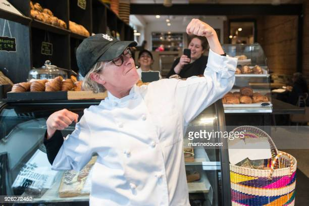"funny portrait of mature strong woman owner of a small bakery shop. - ""martine doucet"" or martinedoucet stock pictures, royalty-free photos & images"