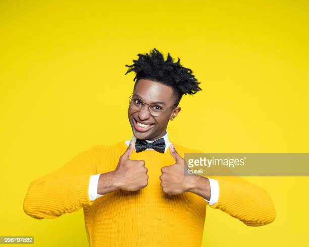 Funny portrait of nerdy young man with thumbs up