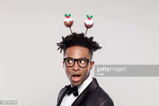 funny portrait of surprised elegant man wearing christmas headband - izusek stock pictures, royalty-free photos & images