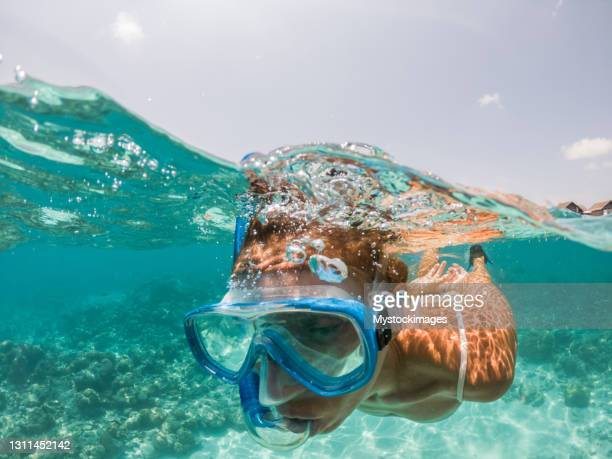 funny portrait of woman snorkelling - diving into water stock pictures, royalty-free photos & images