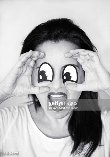 funny portrait, spying through the look. - carmen bella foto e immagini stock