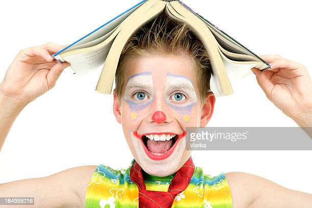 funny reading - happy clown faces stock photos and pictures