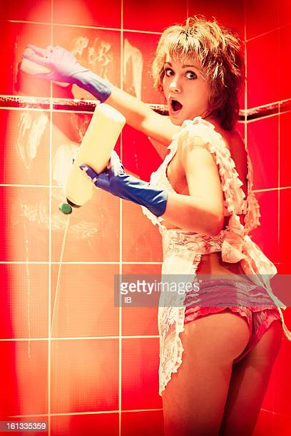 funny scared sexy girl washes walls in the bathroom - wet knickers stock pictures, royalty-free photos & images