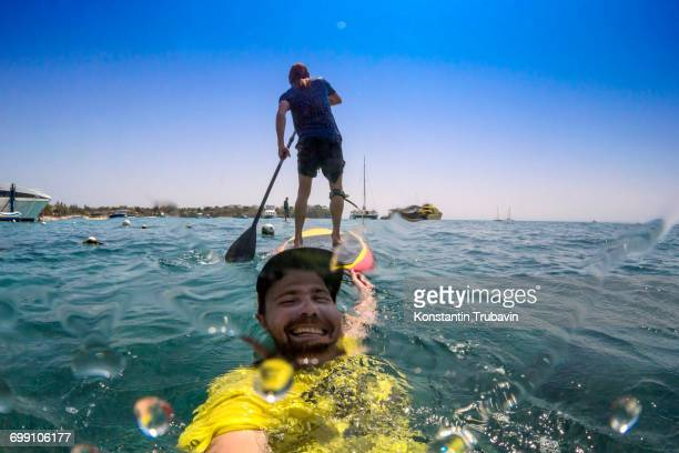 Funny selfie with sup surfer.