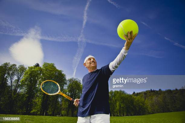 funny senior adult playing tennis - man with big balls stock photos and pictures
