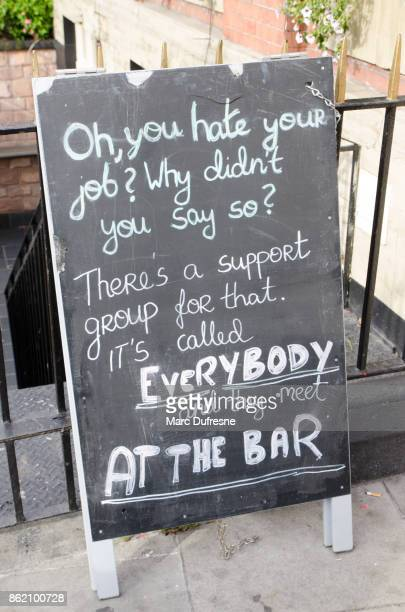 funny sign at entrance of a bar to invite people to get in - alcoholics anonymous stock pictures, royalty-free photos & images