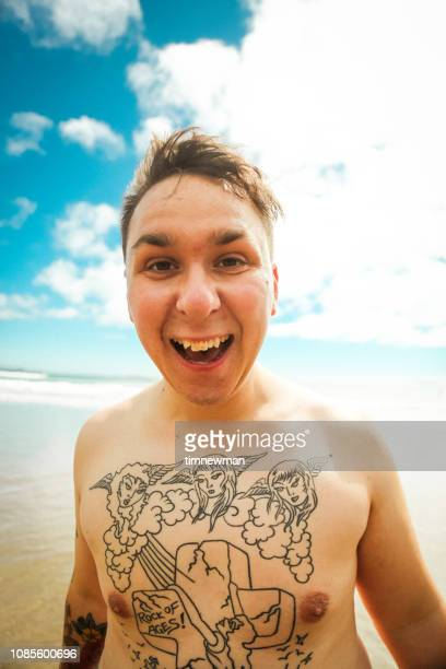 Funny Tattooed Young Man On Beach