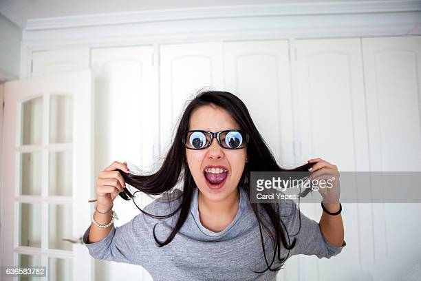 funny teen in comedy glasses - girl nerd hairstyles stock photos and pictures