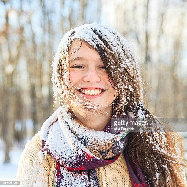 funny teenager girl portrait with the snow on the hair