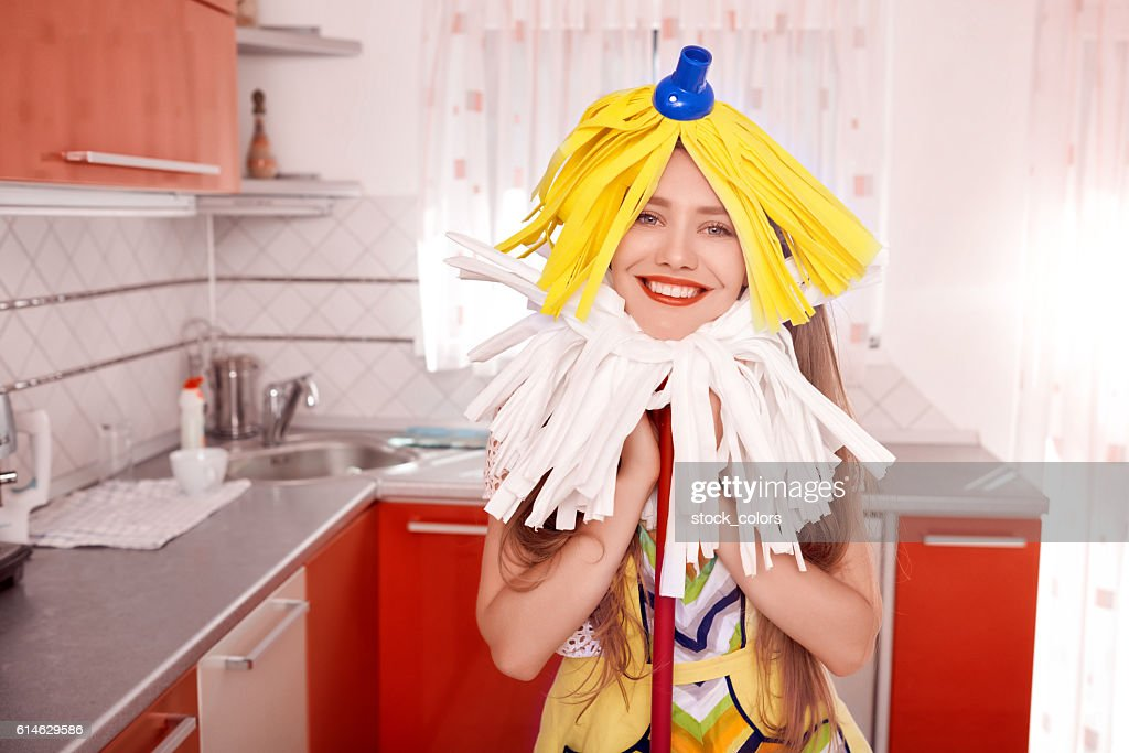 Funny Woman Cleaning Her Kitchen Stock Photo - Getty Images
