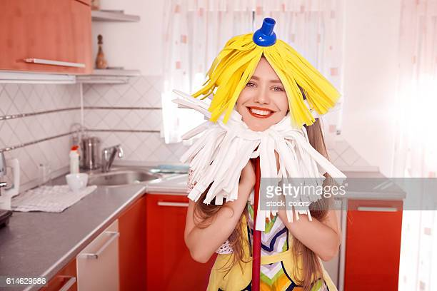 funny woman cleaning her kitchen
