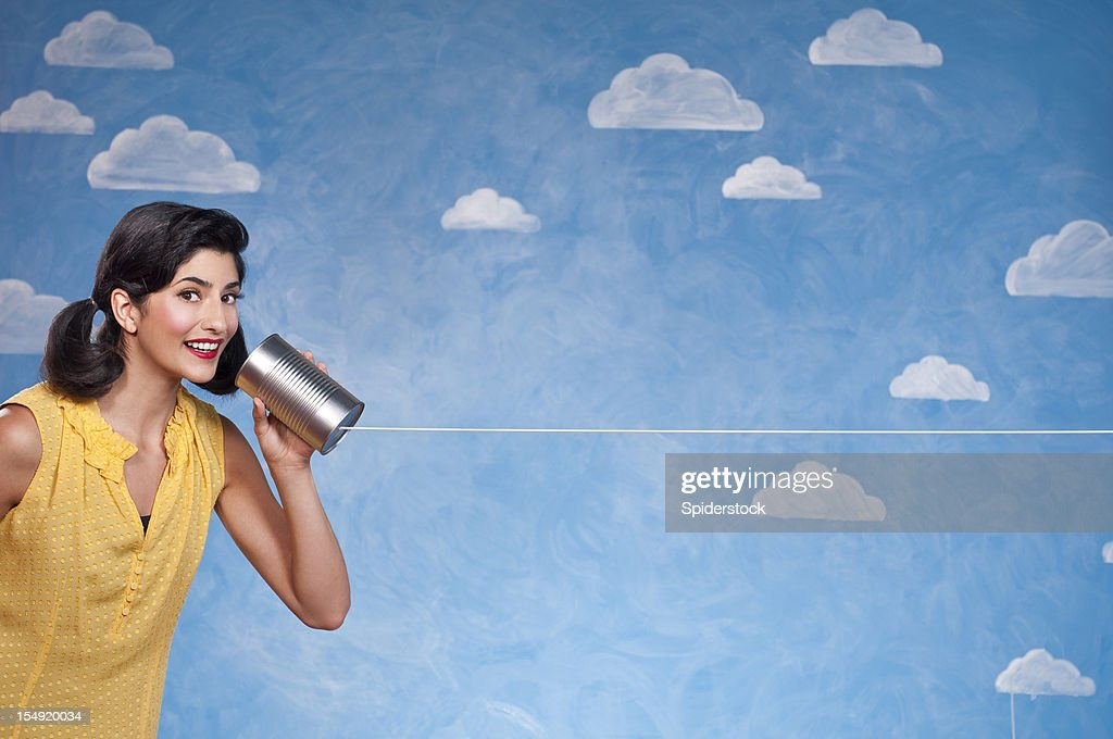Funny Woman With Tin Can Telephone : Stock Photo