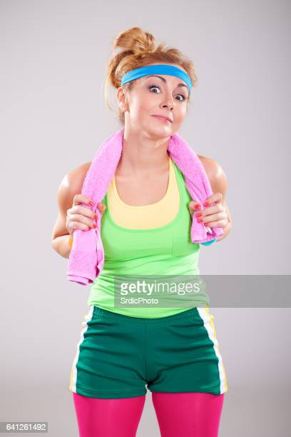 Funny young fitness girl with towel