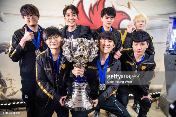 FunPlus Phoenix celebrate with the League of Legends Summoner's Cup following the 2019 League of Legends World Championships at AccorHotels Arena on...