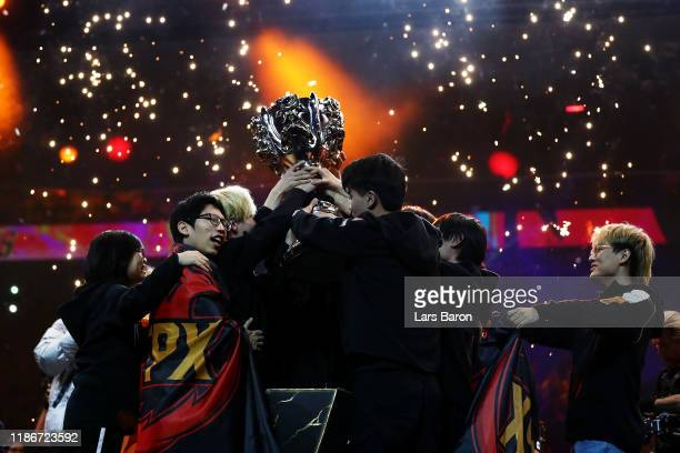 FunPlus Phoenix lift the League of Legends Summoner's Cup following victory in the 2019 League of Legends World Championships at AccorHotels Arena on...