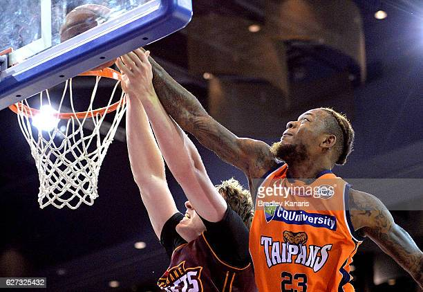 Fuquan Edwin of the Taipans blocks a shot at basket by Cameron Bairstow of the Bullets during the round nine NBL match between the Brisbane Bullets...