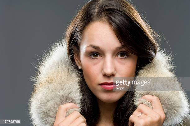 fur collar around young brunette - collar stock photos and pictures