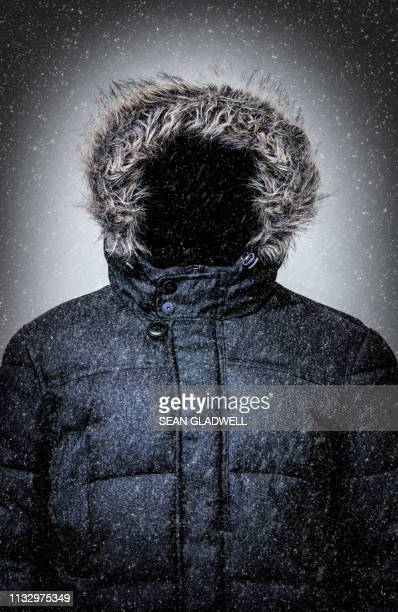 fur lined hooded winter jacket with snow - fur jacket stock pictures, royalty-free photos & images