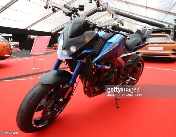 A Furion hybrid motorcycle is displayed at The International Automobile Festival in Paris on January 31 2018 / AFP PHOTO / JACQUES DEMARTHON