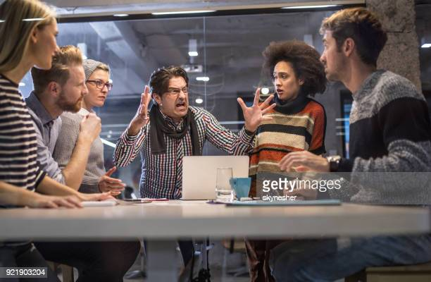 furious boss shouting at his team on a meeting in the office. - negative emotion stock pictures, royalty-free photos & images