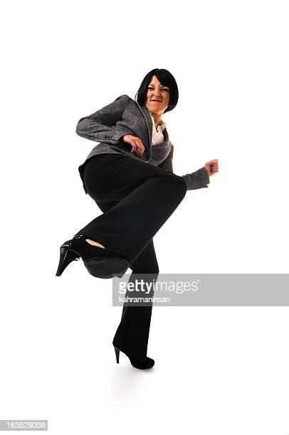 Furious businesswoman kicking on white background