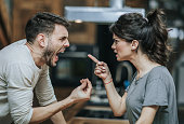 Furious couple arguing while having problems in their relationship.