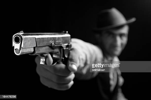Furious gang member pointing gun