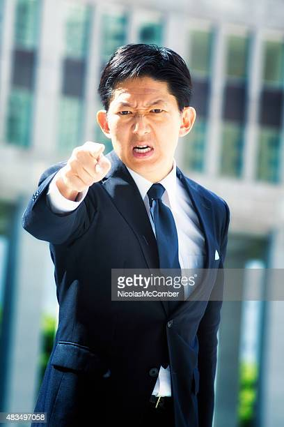Furious Japanese businessman points and threatens
