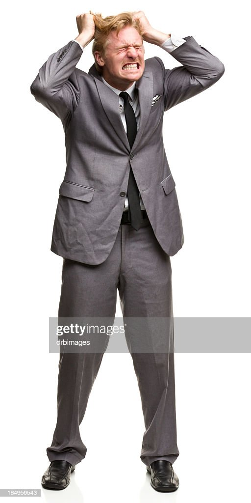 Furious Man in Suit Tearing Out Hair : Stock Photo