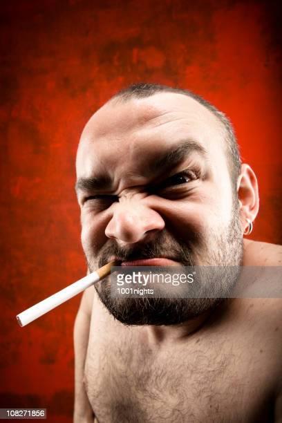 furious man smoking - ugly bald man stock photos and pictures