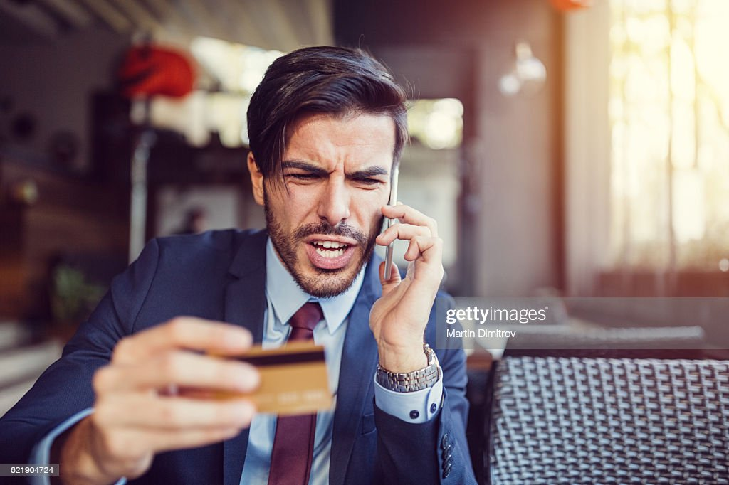 Furious man with empty credit card : Stock Photo
