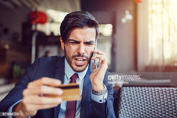 furious man with empty credit card - fraud stock pictures, royalty-free photos & images