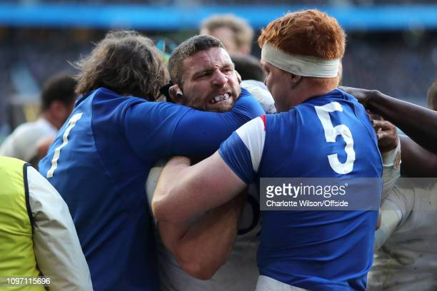 Furious Mark Wilson of England is held in a headlock as a fight breaks out during the Guinness Six Nations match between England and France at...