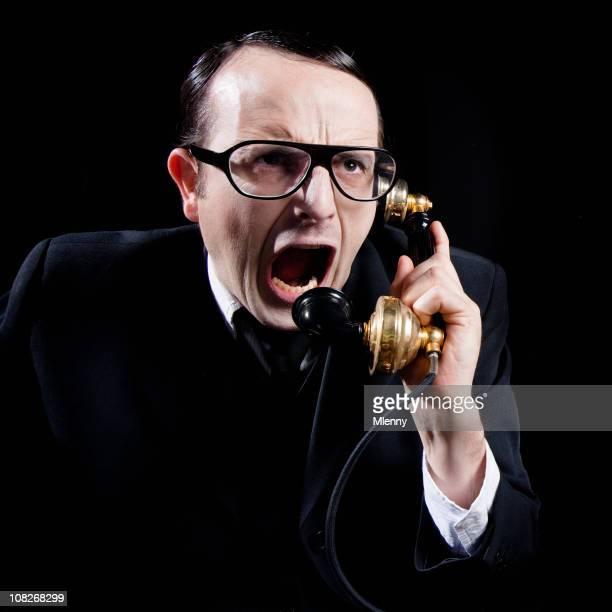 furious on the telephone - klagen stockfoto's en -beelden