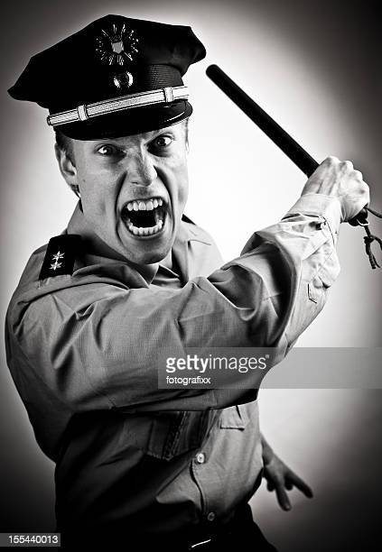 furious police officer - truncheon stock pictures, royalty-free photos & images