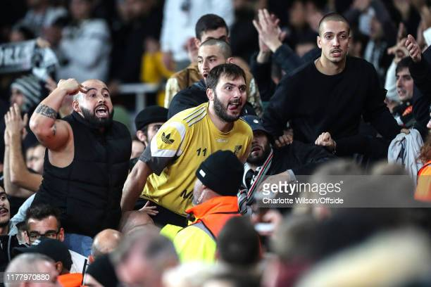 Furious Vitoria fans hurl abuse at Arsenal fans after losing in injury time after the UEFA Europa League group F match between Arsenal FC and Vitoria...