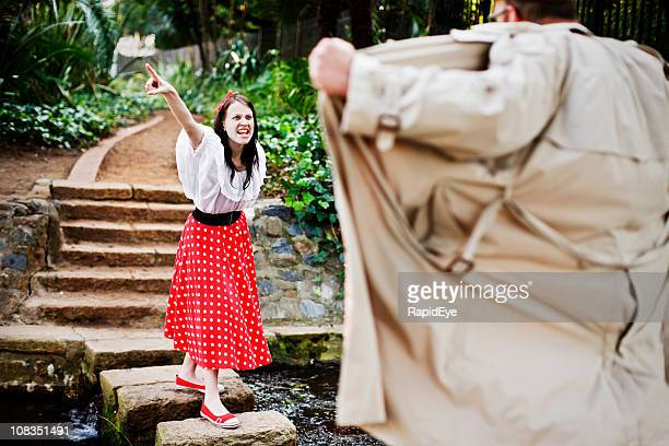 furious young woman defies a flasher in the park - female streaker stock pictures, royalty-free photos & images